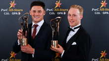 Lee Chin and Diarmuid O'Keeffe with their All Star awards in the Convention Centre in Dublin on Friday (November 1)