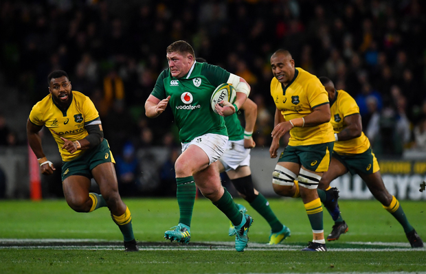 Tadhg Furlong breaks clear of Marika Koroibete and Caleb Timu of Australia during the second test in Melbourne on Saturday