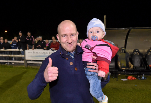 Shane Keegan celebrating with his son, Conor, after Wexford Youths gained promotion with a win over Athlone Town last September