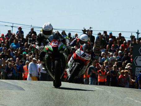 Derek Sheils leads eventual winner Michael Dunlop during the lap record-breaking Grand Final at the Skerries 100. Picture: Pat Nolan