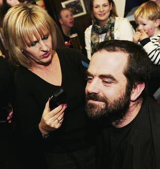 Lorcan O'Brien goes under the razor at the charity shave in Gormley's of Garristown.