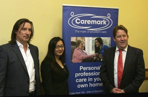 Paul Boucher, Managing Director, and Helen Chan, National Training & Support Manager from Caremark Ireland, with Senator Darragh O'Brien at the launch of Caremark's new children's services