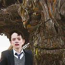Lewis MacDougall as Conor with the creature (voiced by Liam Neeson) in A Monster Calls