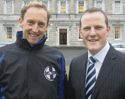 Barry Andrews, Chief Executive of GOAL, with Deputy Alan Farrell.