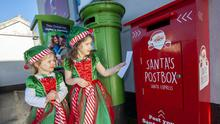 Amber and Charlotte Cooney Rowe at Santa's postbox in Ballyboughal. (pics by Fintan Clarke)