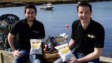 Tom and Ross Keogh of Keogh's crisps with their latest flavour in their range, Irish Atlantic Sea Salt