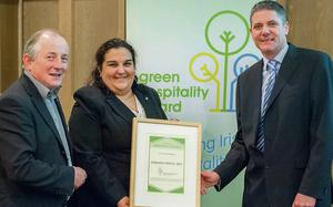 Ines Guerra from the Carlton Hotel collects the Green Hospitality Award from Maurice Bergin and James Hogan in the Radisson Blu Royal Hotel.