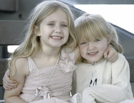 Little Rebecca Lawlor, aged five (pictured on the right) with her older sister, Grace.
