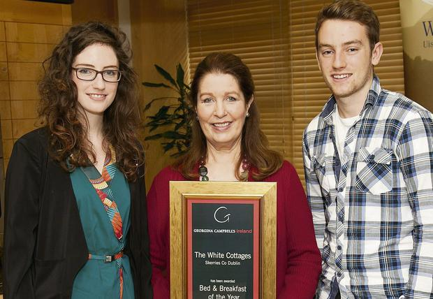Georgina Campbell (centre) presents Jessica and Luke O'Connor of The White Cottages in Skerries with her B&B of the Year Award in 2013. Picture: Paul Sherwood