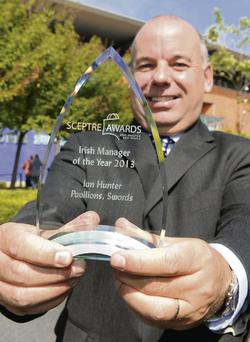 Ian Hunter, manager of the Pavilions Shopping Centre, with the Sceptre Award for Irish Manager of the Year.