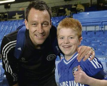 Oran Tully from Skerries with Chelsea's John Terry at Stamford Bridge.