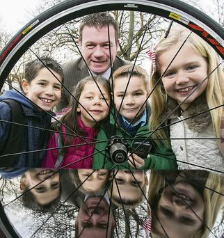 Alan Kelly TD, Minister for Commuter and Public Transport with children, from left: Mark Casey 8, Beaumount; Rebecca Moriarty 7, Malahide; Max Donovan 7, Navan Road; Jody Costello, 8, Malahide; at the launch of the New Cycle Planner App which allows people to customise their bike trips.