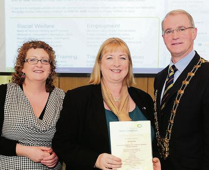 Tutor Grainne Ward and Fingal Mayor Kieran Dennison presenting Ger Dowling with her CIS Certificate
