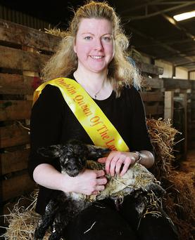 Lorna Sweetman, Dublin's 'Queen of the Land', with a lamb she delivered about 30 minutes before the photograph was taken.