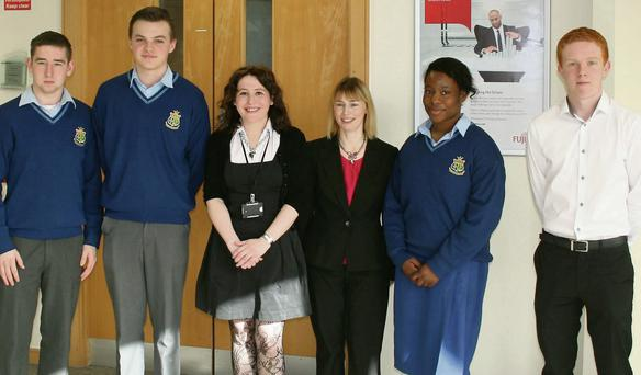 Fujitsu staff members Anita O'Grady and Fiona Maxwell with students taking part in the Skills at Work Programme.