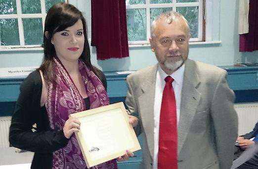 Rebecca O'Reilly, Foróige, receiving the Jim Quigley Award for Young Volunteer of the Year from Martin Russell, Chairperson of the Skerries Community Association