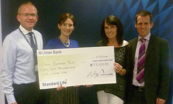 Nigel Dunne and Fiona Keane from Standard Life presenting the cheque for €87,700 to Nuala and Pat Brennan for the Laura Brennan Trust.