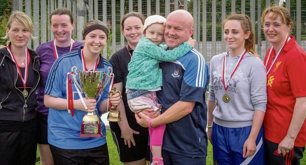 The winning ladies team with Molly and Gerard McNally.