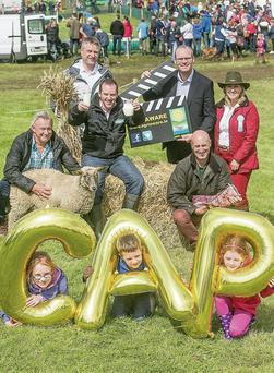 Pictured with Minister for Agriculture, Food the Marine and Defence, Simon Coveney and Agri Aware's Executive Director, Dr. Vanessa Woods, launching Agri Aware's 'Follow the Farmer' videos, to communicate the reformed CAP to farmers and the general public, at Tullamore Show, are (L-R): James Lally (sheep farmer from Mayo); David Rogers (tillage farmer from Dublin); Andrew Gow (dairy farmer from Limerick) and Angus Woods (beef farmer from Wicklow), along with Leah Gow, Kyle Gow and Caragh Gow.