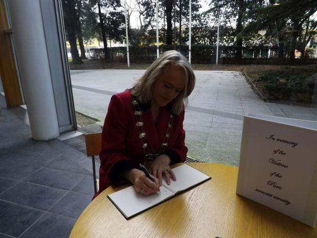Mayor of Fingal Cllr Mags Murray signs the book of condolence at the County Hall in Swords on Monday