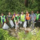 Cllr Darragh Butler (FF) and Cllr Joe Newman (NP) pitch in with Swords Tidy Towns at river clean up