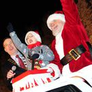 Mayor of Fingal Cllr Darragh Butler, with his son Adam and Santa at the turning on of the lights in Swords