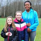 Isabelle Keating, Amelia Keating and Sammy Somide with Boo at the Operation Transformation walk/run