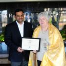 Mary McCormack who received a WMC Social Responsibility Award from the World Malayalee Council charity, with Babu Joseph, secretary of the World Malayalee Council Ireland.