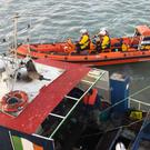 Skerries RNLI members escort the vessel to safety