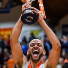Isaac Westbrooks of Griffith Swords Thunder lifts the trophy