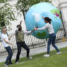 Pupils from Balbriggan Educate Together National School have made it through to the final of the World Irish Aid Awards. Pictured are from left Dario Cucu, Abdulwaaris Jimoh and Rima Almare as they try and stop an inflated world from taking off