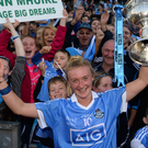 Carla Rowe of Dublin celebrates with the Brendan Martin Cup following the TG4 Ladies Football All-Ireland Senior Championship Final match between Dublin and Mayo at Croke Park in Dublin