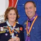 Cub Scout Leader Anna Hickey being presented with her Forty Years' Service Award by Chief Scout Christy McCann.
