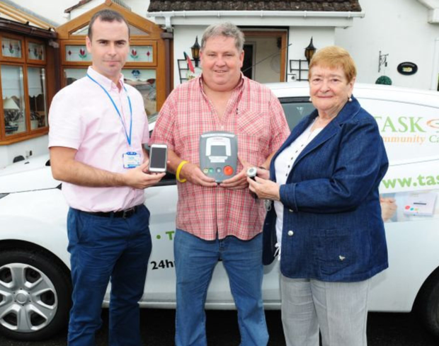 Frank Fleming (centre) of Fingal Community Alert with Task Community Care Ronan Bunting and vice chair Nuala Deignan which will install free panic alarms to elderly people in their homes