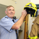 Dermot Maypotter hanging up his fire helmet for the last time
