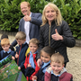 Mairead Murphy, Principal Scoil Oilibhear Naofa, Kevin Tolan, Chairperson BCA and schoolchildren with artist's impression of playground