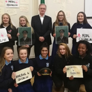 Leo Quinlan with students from Malahide Community School who are campaigning for a Medal of Honour for his father, Commandant Pat Quinlan