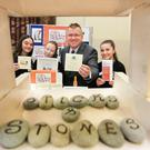Oisin Geoghegan with Sticks and Stones craft company members