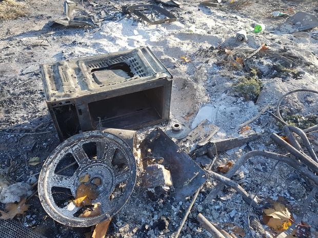 The remains of a bonfire, including a microwave oven, in Swords.