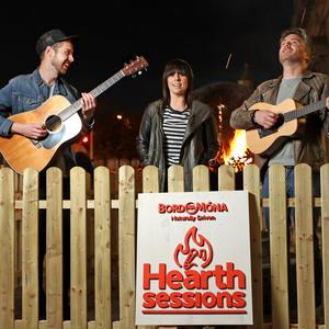 Swords musician Conor Adams (left) and his band All Tvvins are headlining Bord na Mona hearth sessions. Pictured is Conor with Stephanie Rainey and his bandmate Lar Kaye