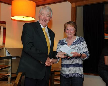Terry Quinlan makes a presentation to Evelyn Doyle