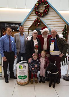With Santa are Brian Brodigan of Specsavers, Peter Carey of Millfield Shopping Centre, Breege O'Neill from the local branch of Irish Guide Dogs, Brooke Daly, Katie O'Neill and Gatsby the dog with his owner, Tom O'Neill.