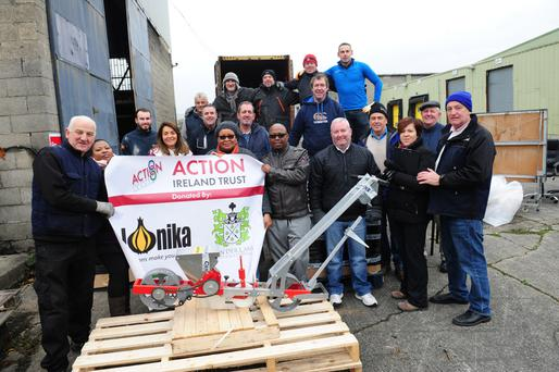 Action Ireland Trust volunteers fill the container set for Lesotho.