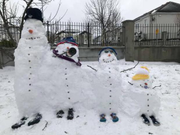 This snow family appeared after the recent cold snap