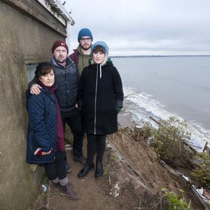 Grainne Hannigan, Lawrence Murray, Amy Hannigan and Aaron Weafer at the property in Portrane which is under threat from coastal erosion.