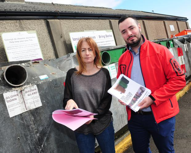 Deputy Clare Daly TD and activist, Dean Mulligan launching their report on bin services, in Swords.
