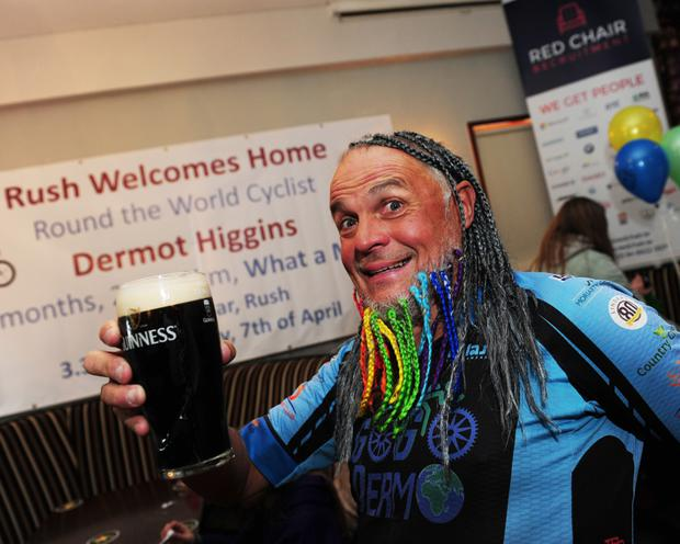 Rush welcomes home round the world cyclist Dermot Higgins.