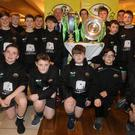 Balbriggan RFC under-13s with Six Nations and Triple Crown trophies