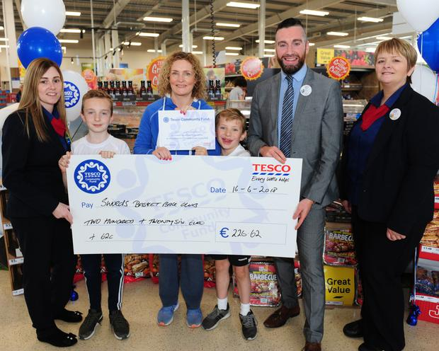 Store Manager Gary Redmond, staff Carol Murray and Nicola Fagan with Roisin Dixon and Neil and Shane Gorman from Swords Basketball Club at the Tesco Community Tea Day Fundraiser at Airside