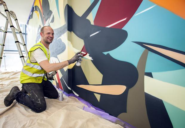 James Earley prepares his 'Light Years' art installation at Dublin Airport